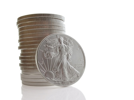 Stack of twenty uncirculated liberty silver dollars on white Stock Photo - 9197355