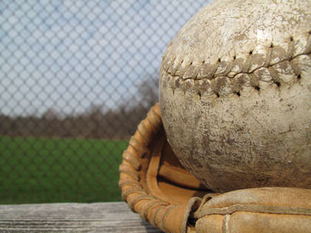catchers mitt: Well used softball and catchers mitt with shallow depth of field