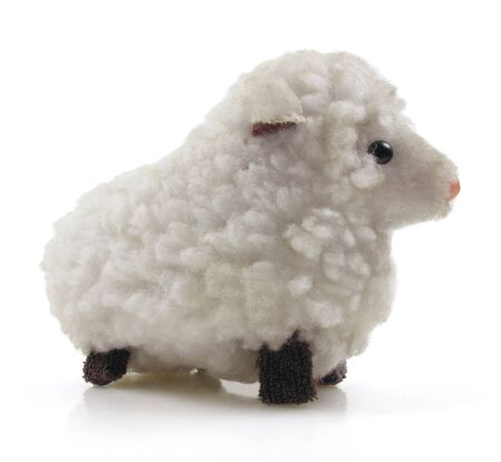 Small vintage wind-up toy sheep on white