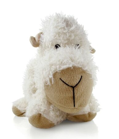 Vintage generic stuffed toy sheep on a white background
