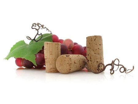 Plump red grapes and corks suggest wine is on the way Stock Photo