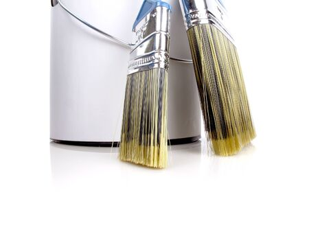 doityourself: Bright, high-key image of a paint can and paintbrushes on white