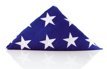 Traditional folded flag presented to the family of US veterans of the armed services Stock Photo - 10195662