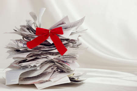 Beautiful holiday tree made of receipts with a red ribbon photo