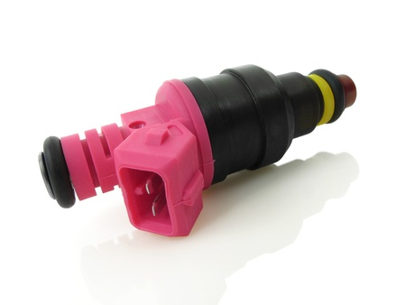Bright pink fuel injector on a white relective background