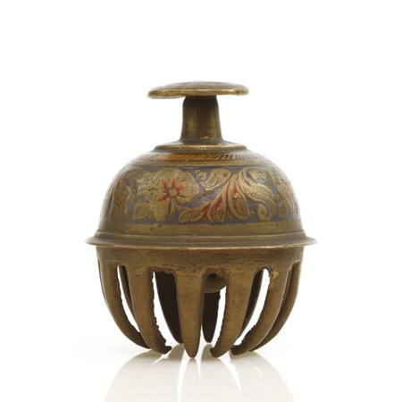 inlaid: Antique brass bell from India is inlaid with gemstones