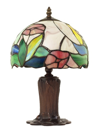 Artful, beautiful little stained glass lamp with a brass base on white