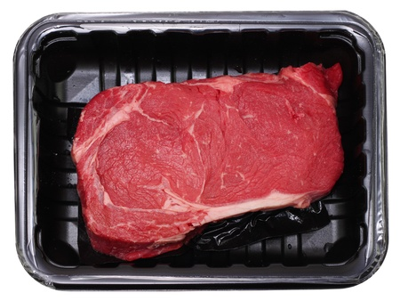 Fresh delmonico or rib eye steak isolated on white in black package