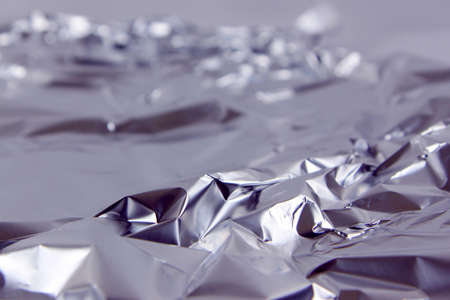 A large sheet of crumpled aluminum foil makes a colorful and intersting background Stock Photo - 12822017