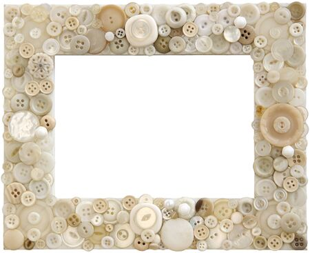 A picture frame cleverly adorned with various shades of white buttons Banco de Imagens