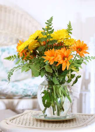 brighten: Colorful bouquet of fresh gerbera daisies brighten a tropical sun room Stock Photo