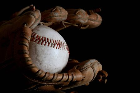 hardball: Baseball mitt and vintage hardball in black