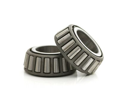 Two precision metal bearings on a white background