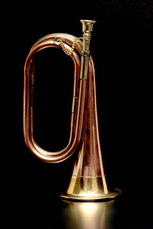 Brigh brass and copper retro bugle isolated on black