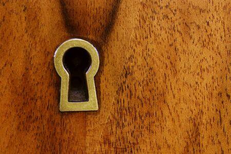 mahogany: Closeup view of a brass keyhole on mahogany Stock Photo