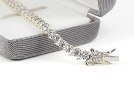 Diamond tennis bracelet in box isolated on white Standard-Bild