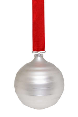 silvery: Silvery white Christmas ornament hanging from a red ribbon on white Stock Photo