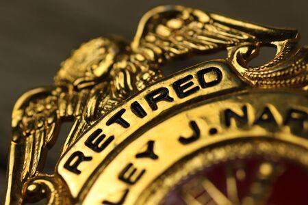 Close-up van een badge uitgereikt aan een ambtenaar
