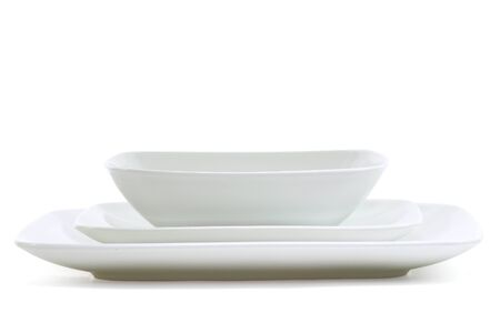 Set of white square dinner plates on white