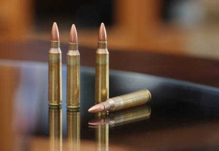 Four rifle bullets Stock Photo