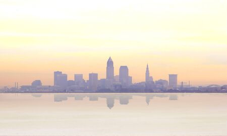 Sunrise reveals a misty Cleveland skyline