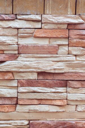 Closeup texture of rough weathered gray brick wall background