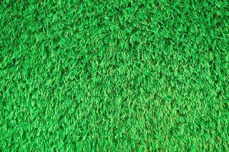 Artificial playground grass field closeup texture background