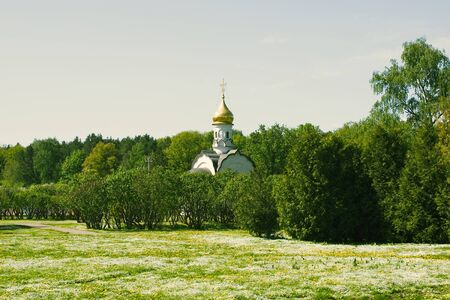 Orthodox white chapel in Moscow park in Russia background
