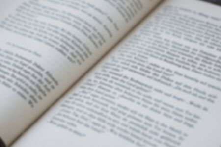 Opened old german book's pages blurred close-up background