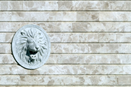 Lion head relief on the facade Stock Photo