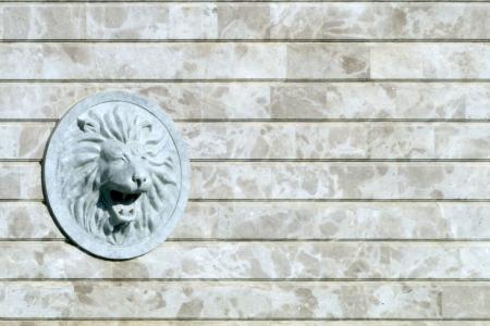 Lion head relief on the facade Stock Photo - 17589515