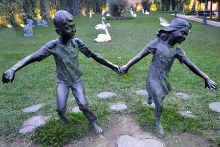 statues of children