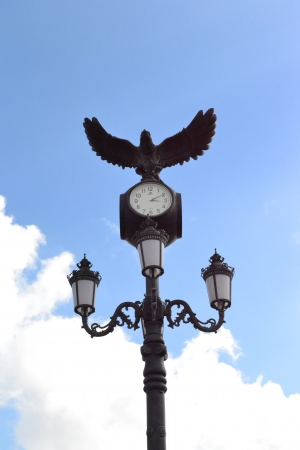 sculpture of an eagle on the clock Stock Photo