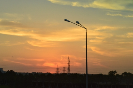 sunset over the road