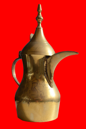 Arabic jar or coffee pot decorated with ornaments