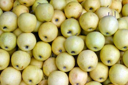 Yellow juicy fresh apples background Stock Photo