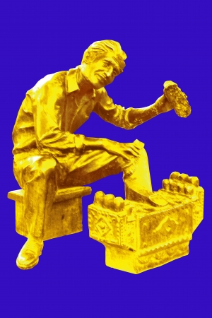 isolated golden sculpture shoe shiner
