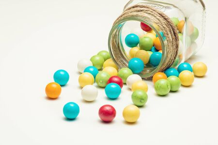 Colored chewing gum balls in container