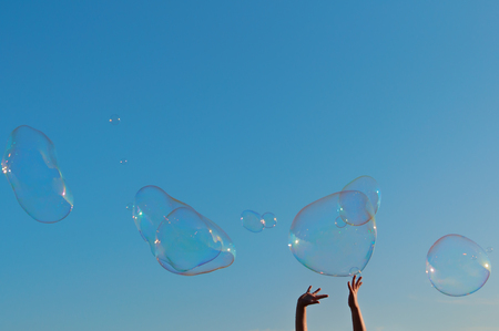 The gigantic soap bubble toy with blue sky background