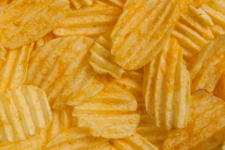 serrate: The corrugated potato chips in the background