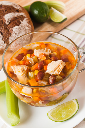 Mexican soup with chicken, celery and vegetables closeup Stock Photo