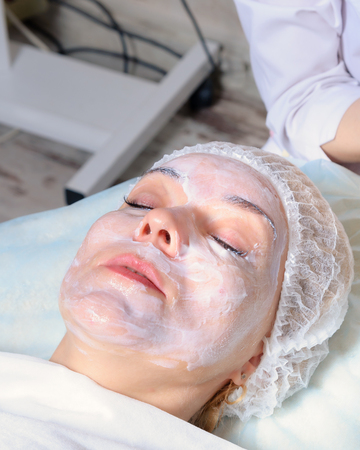 salon and spa: The beautician prepares face girls cream anesthetic before beauty Stock Photo