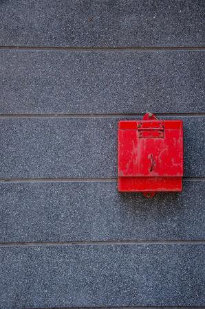 await: red mail box put on gray flagstone Stock Photo