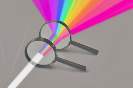 wavelengths: Rainbow spectrum of rays of white light through two magnifying glasses, arranges according to wavelengths