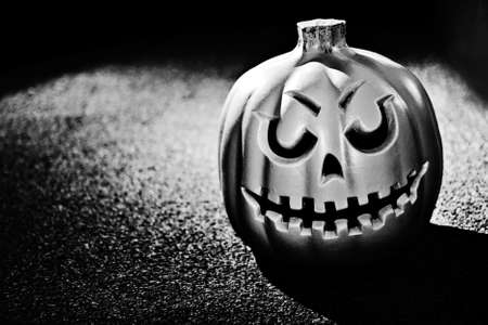 Single pumpking against a heavily textured background in black and white Stock Photo