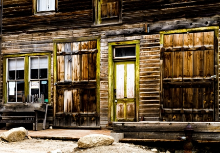 western usa: Wooden storefront of an old mining ghost town that is weathered. Stock Photo