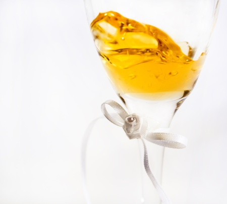 Wine inside a glass showing slight movement, image fades into and is isolated against a white background Stock Photo
