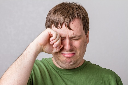 crying face: Guy who is very upset for who knows what. He is just crying and making big baby sad faces.