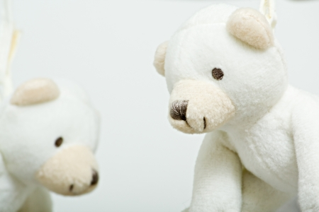 teddybear: White teddy bears hanging from a childs mobile
