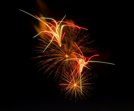 Fireworks display that is centered showing exploding fireworks plus streams  Image is isolated against black making it easy to add copyspace in any direction so you can add your own text
